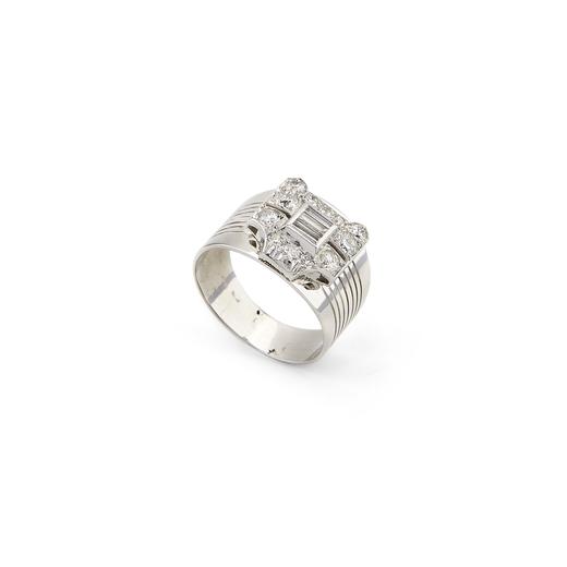 ANELLO A FASCIA IN ORO E DIAMANTI la parte superiore decorata con diamanti di taglio baguette, huit-